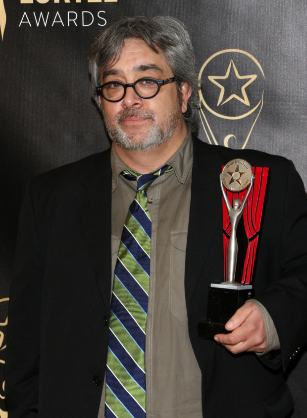 <p>Stephen Adly Guirgis with his Outstanding Play Lucille Lortel Award for <em>Between Riverside and Crazy</em>.</p><br />(© David Gordon)