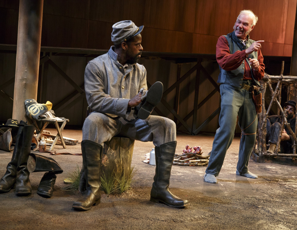 <p>Sterling K. Brown as the enslaved Hero with his master, played by Ken Marks, in Part 2 of Suzan-Lori Parks&#39&#x3B; historical piece.</p><br />(© Joan Marcus)