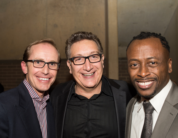 <p>Tectonic Theater Project&#39&#x3B;s Ted Trimpa, Director Moisés Kaufman, and Music Director Kenny J. Seymour enjoy opening night together.</p><br />(© Cameron Whitman Photography)
