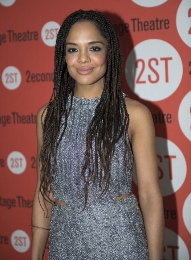 <p>Tessa Thompson works the red carpet after the show.</p><br />(© Allison Stock)