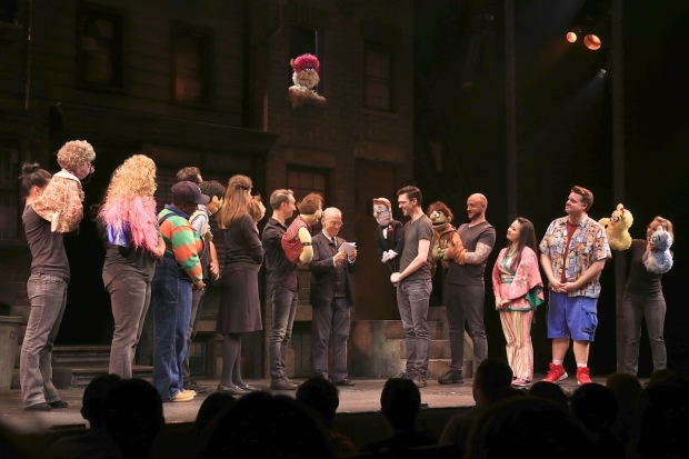 <p>The <em>Avenue Q</em> company witnesses the vow renewal between Ricky and Rod.</p><br />(© Tricia Baron)