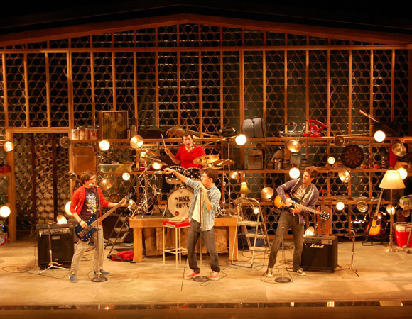 <p>The band rehearses for their first gig.</p><br />(© TheaterMania)