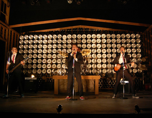 <p>The Black Suits rock out at the St. Ann&#39&#x3B;s Battle of the Bands.</p><br />(© TheaterMania)