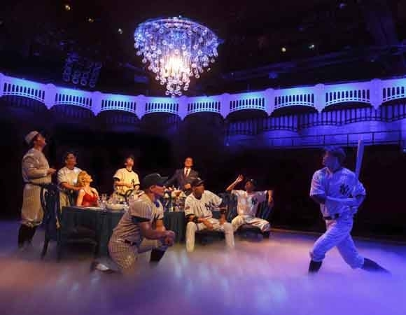 <p>The <em>Bronx Bombers</em> enjoy a fantasy dinner party.</p><br />(© Joan Marcus)