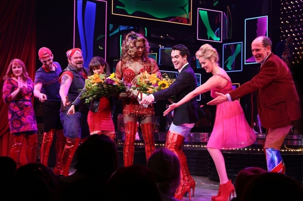 <p>The cast acknowledges the orchestra at curtain call.</p><br />(© Tricia Baron)