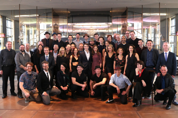 <p>The cast and creative team of <em>Bandstand</em> poses for a photo.</p><br />(© David Gordon)