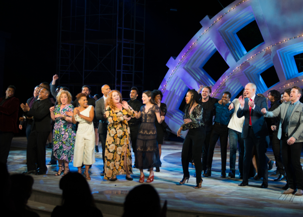 <p>The cast celebrates at curtain call.</p><br />(© Allison Stock)