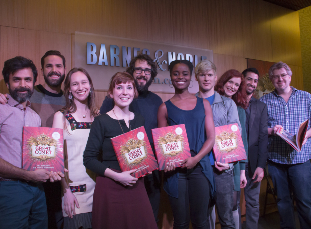 <p>The cast holds up copies of <em>Natasha, Pierre &amp&#x3B; The Great Comet of 1812: The Journey of a New Musical to Broadway</em>.</p><br />(© David Gordon)