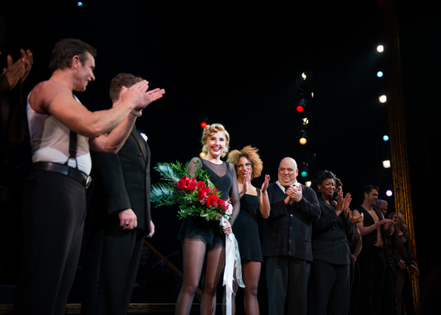 <p>The cast of <em>Chicago</em> welcomes Veronica Dunne to the Ambassador Theatre.</p><br />(© Allison Stock)