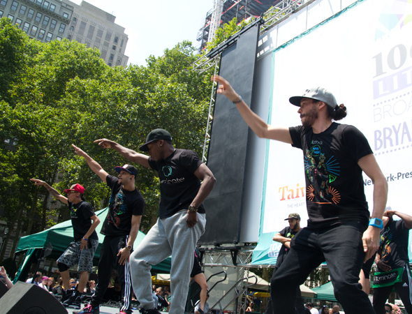 <p>The cast of <em>iLuminate</em> performs at Broadway in Bryant Park.</p><br />(© David Gordon)