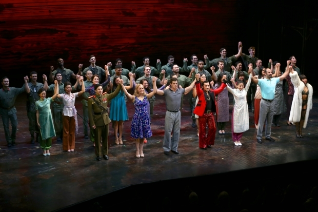 <p>The cast of <em>Miss Saigon</em> takes a bow.</p><br />(© Tricia Baron)