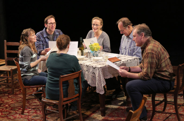<p>The cast of <em>Regular Singing</em> bond over sheet music at the dining table.</p><br />(@ Joan Marcus)
