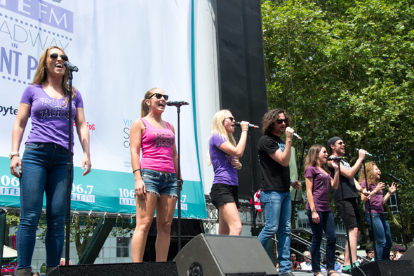 <p>The cast of <em>Rock of Ages</em> closes Broadway in Bryant Park.</p><br />(© David Gordon)