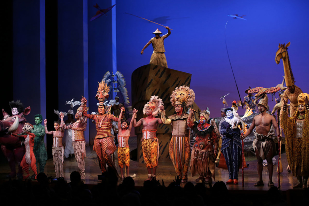 <p>The cast of <em>The Lion King</em> takes a bow after the 20th anniversary performance.</p><br />(© Walter McBride)