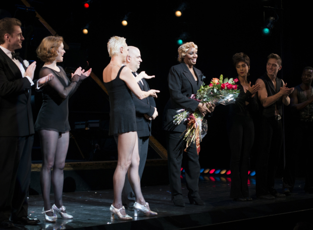 <p>The <em>Chicago</em> cast singles out Leakes for a solo bow.</p><br />(© Allison Stock)