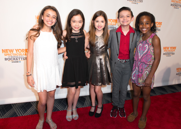 <p>The children of <em>School of Rock</em> take in the <em>New York Spectacular</em>.</p><br />(© Allison Stock)