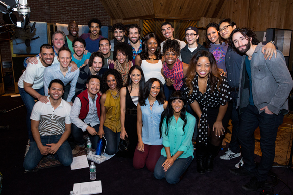 <p>The company comes together to celebrate a successful day recording the <em>Aladdin</em> cast album.</p><br />(© Matthew Murphy)