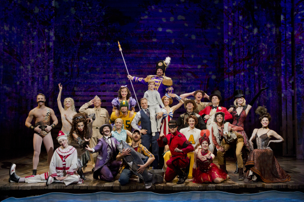 <p>The company of Big Fish enjoys a moment together onstage.</p><br />(© Paul Kolnik)