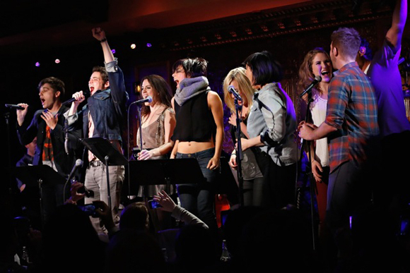 <p>The company of <em>Hit List</em> celebrates onstage at 54 Below.</p><br />(© Cindy Ord/Getty Images)