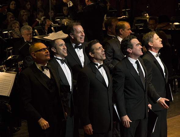 <p>The concert&#39&#x3B;s male ensemble gathers together onstage.</p><br />(© David Gordon)