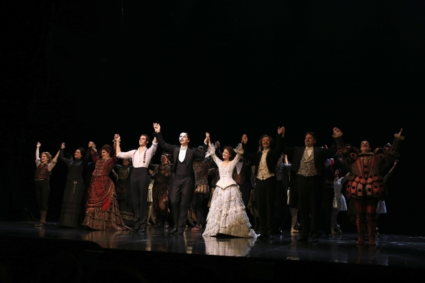 <p>The ensemble drinks in their applause.</p><br />(© Tricia Baron)