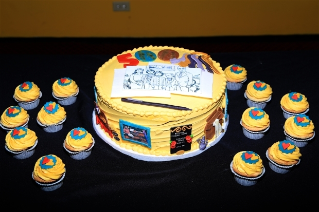 <p>The <em>Fun Home</em> team gets a &quot&#x3B;fun&quot&#x3B; cake for their 500th performance.</p><br />(© Tricia Baron)