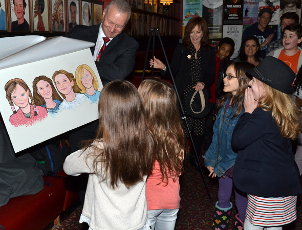 <p>The girls can&#39&#x3B;t contain their excitement as they see their caricature for the first time.</p><br />(© David Gordon)