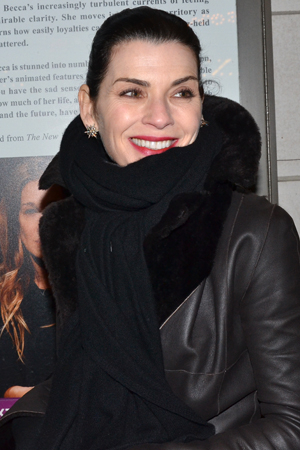 <p><em>The Good Wife</em> star Julianna Margulies is all bundled up to brave the weather and pose for photos.</p><br />(© David Gordon)