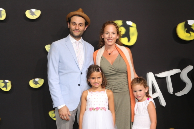 <p><em>The Humans</em> cast member Arian Moayed and his wife, Krissy Shields, take in <em>Cats</em> with their daughters, Olive and Ivy.</p><br />(© David Gordon)