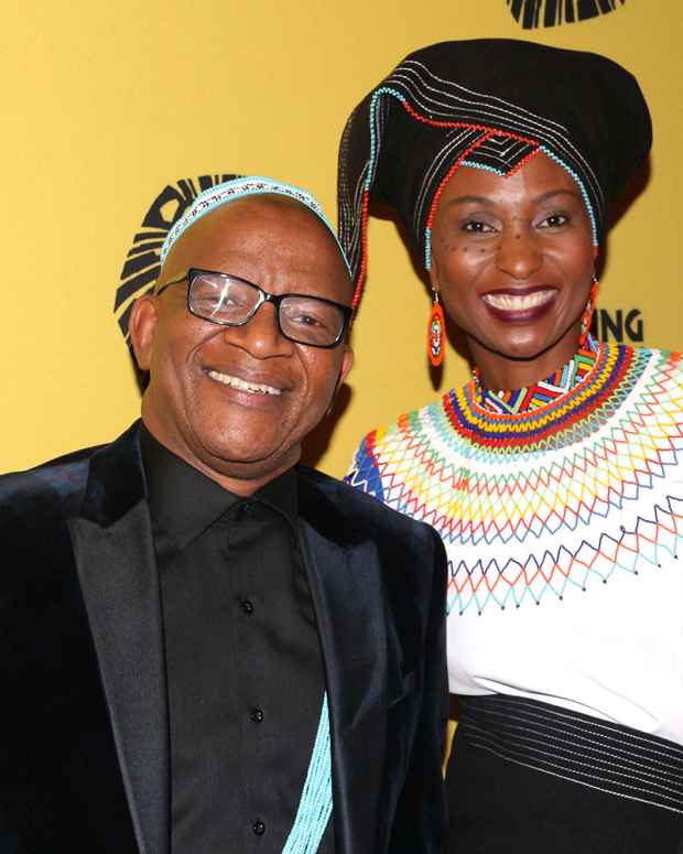<p><em>The Lion King</em> composer Lebo M. and his guest arrive for the show.</p><br />(© David Gordon)