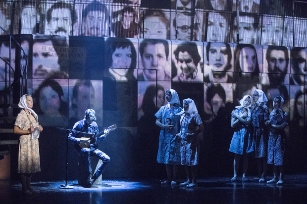 <p>The many faces of Argentina's Disappeared projected behind the ensemble.</p><br />(© Gretjen Helene)