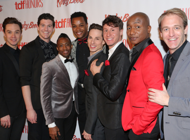 <p>The men of <em>Kinky Boots</em> smile for the cameras.</p><br />(© David Gordon)