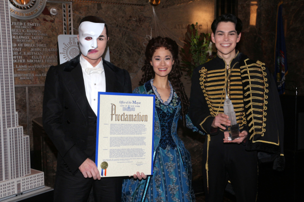 <p>The stars with a proclamation declaring Friday, January 26, <em>Phantom of the Opera</em> Day in New York City.</p><br />(© David Gordon)