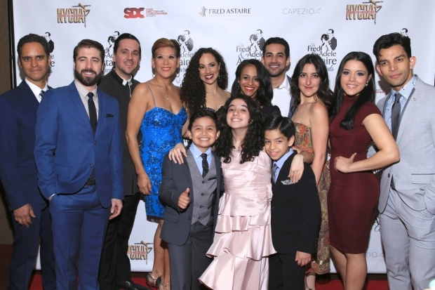 <p>The team from <em>On Your Feet!</em> celebrates their Best Ensemble in a Broadway Show nomination.</p><br />(© Tricia Baron)