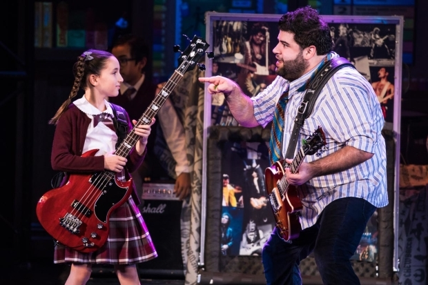 <p>Theodora Silverman gets a lesson on how to rock from Rob Colletti.</p><br />(© Matthew Murphy)