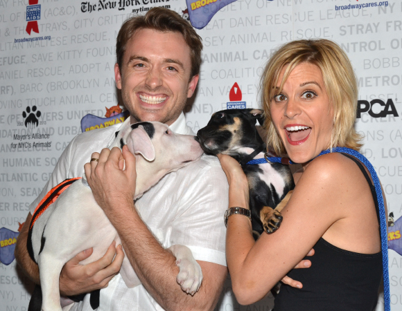 <p>These pups are too cute for <em>If/Then</em> cast mates James Snyder and Jenn Colella to handle.</p><br />(© David Gordon)