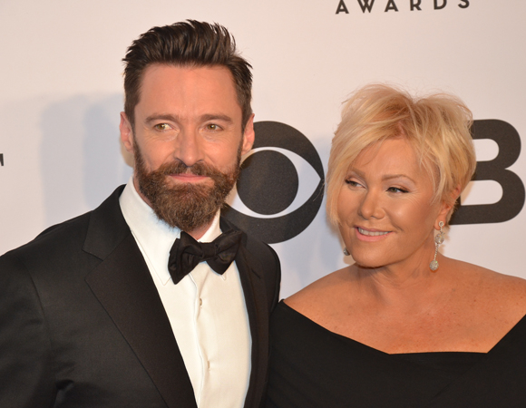 <p>Tony host Hugh Jackman walks the red carpet with his lovely wife, Deborra-Lee Furness.</p><br />(© David Gordon)
