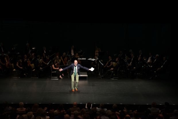<p>Transport Group artistic director Jack Cummings III welcomes the audience to <em>Peter Pan in Concert</em>.</p><br />(© Allison Stock)