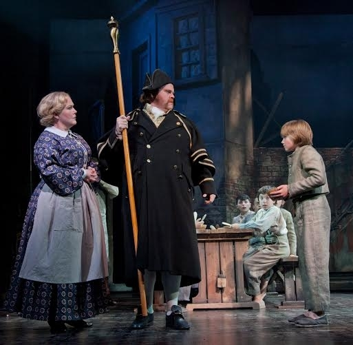 <p>Tyler Moran asks for more food from Jessica Sheridan (Widow Corney) and John Treacy Egan (Mr. Bumble).</p><br />(© Jerry Dalia)