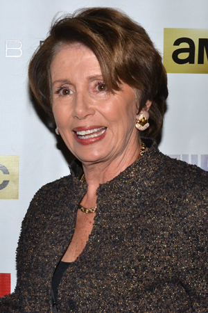 <p>U.S. House of Representatives Minority Leader Nancy Pelosi heads into the Neil Simon Theatre.</p><br />(© David Gordon)