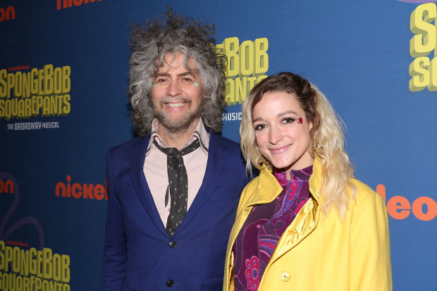 <p>Wayne Coyne of the Flaming Lips, the group that composed &quot&#x3B;Tomorrow Is,&quot&#x3B; poses with a guest on the red carpet.</p><br />(© David Gordon)
