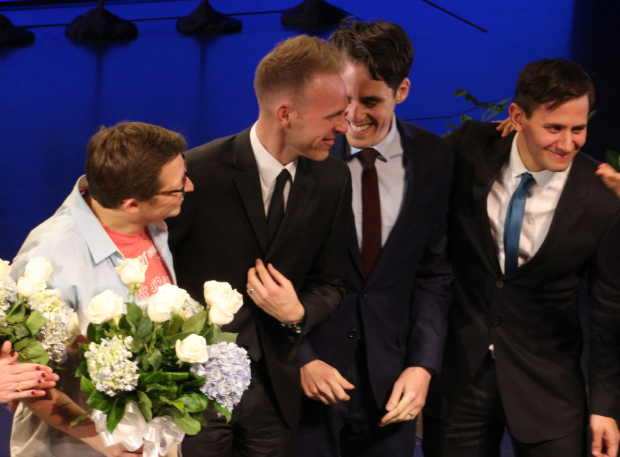 <p>Will Roland looks on as <em>Dear Evan Hansen</em> scribes Justin Paul, Steven Leveson, and Benj Pasek come on stage for a curtain call.</p><br />(© David Gordon)
