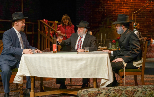 <p>Yankl (Shane Baker) receives advice about his daughter&#39&#x3B;s marriage from Reb Eli (David Mandelbaum) as Sarah (Eleanor Reissa) and the Scribe (Eli Rosen) listen in.</p><br />(© Ronald L. Glassman)