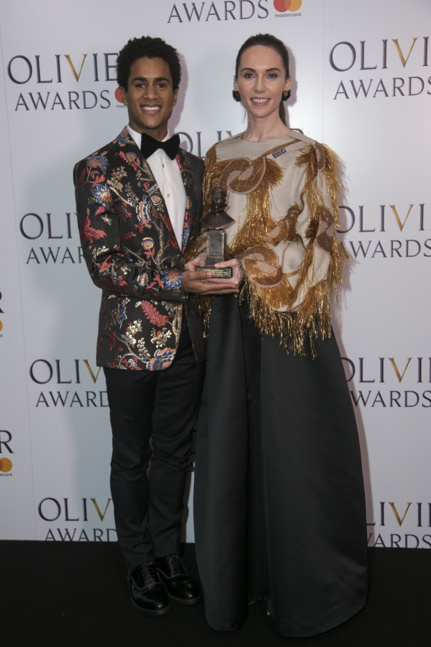 <p>Marcelino Sambe and Kristen McNally accept the award for Best New Dance Production</p><br />© Dan Wooller