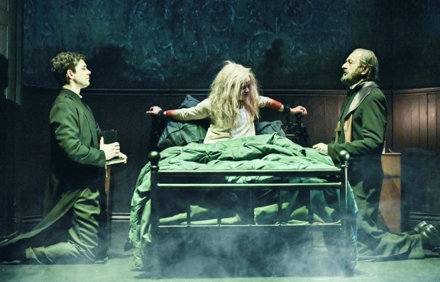 <p>Adam Garcia as Father Karras, Clare Louise Connolly as Regan and Peter Bowles as Father Merrin in <em>The Exorcist</em></p><br />Robert Day