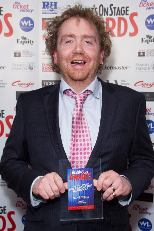 <p>Adam Speers accepts the Award for Best Lighting Designer on behalf of Adam Silverman for <em>Macbeth</em></p><br />© Dan Wooller for WhatsOnStage