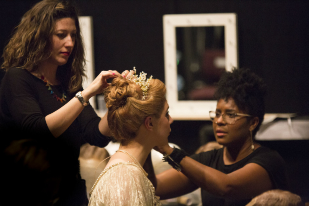 <p>Alison Langer who plays young Heidi in the hair and make-up village backstage having her head piece adjusted </p><br />(c) Ellie Kurttz