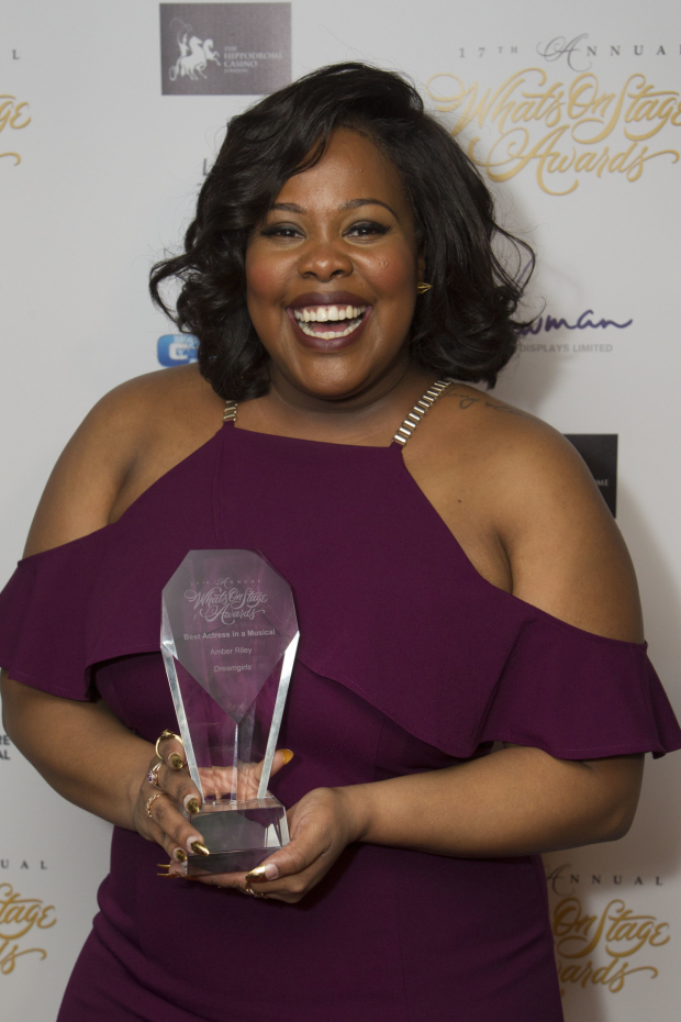 <p>Amber Riley accepts the award for Best Actress in a Musical for <em>Dreamgirls</em></p><br />© Dan Wooller for WhatsOnStage