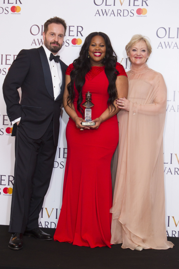 <p>Amber Riley with the award for Best Actress in a Musical for <em>Dreamgirls</em> at Savoy Theatre, presented by Alfie Boe and Maria Friedman</p><br />© Dan Wooller for WhatsOnStage
