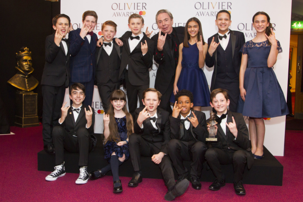 <p>Andrew Lloyd Webber and the cast with the award for Outstanding Achievement in Music for <em>School of Rock the Musical</em> at New London Theatre</p><br />© Dan Wooller for WhatsOnStage